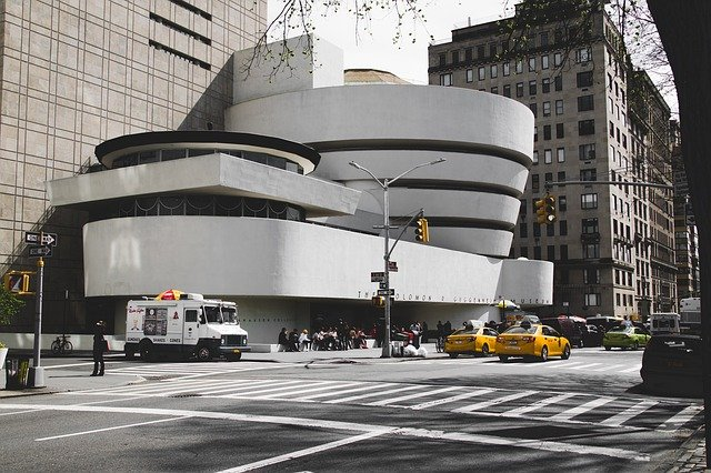 A car parked on the side of Solomon R. Guggenheim Museum