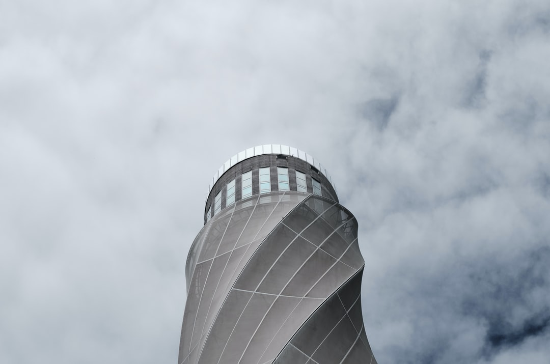 A tower with smoke coming out of it